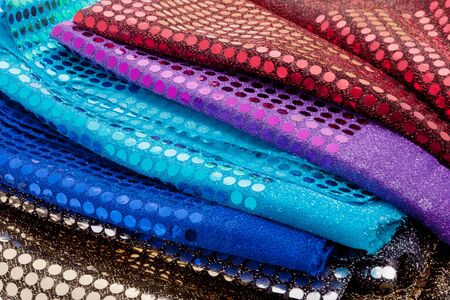 Close up of fabrics with sequins photo