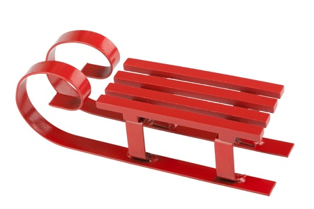 Red sled isolated in front of white background