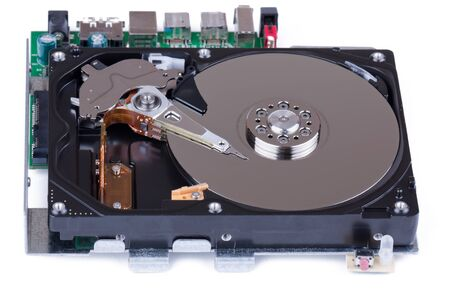 Open hard disk drive in front of white background photo