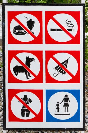 Prohibited sign with different symbols photo