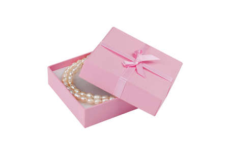 Gift box with pearl necklace in front of white background  photo