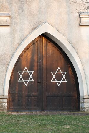 Entrance door of a Jewish cemetery with Stars of David photo