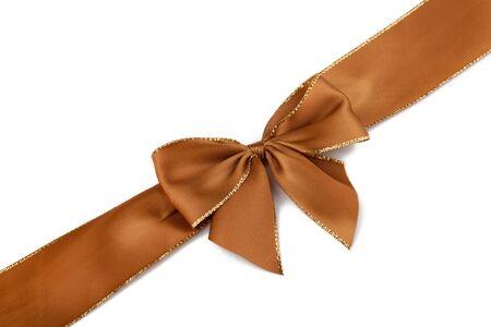 satin ribbon: Brown satin ribbon in front of white background