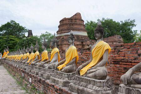 Seated Buddhas in the temple Wat Yai Chai Mongkol in Ayutthaya; Thailand Stock Photo - 17358797