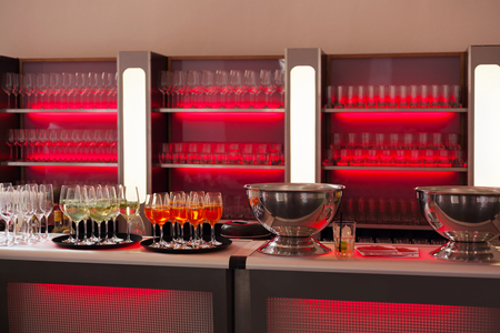 Bar with refreshing drinks and red backlight photo