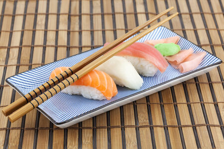 Japanese sushi on a plate with chopsticks Stockfoto