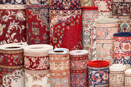 heap of role: Close up of various handmade Persian carpets in a shop Stock Photo