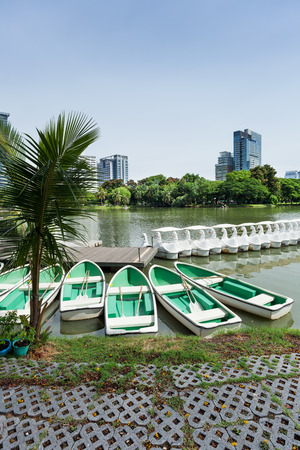 rowboats: Rowboats in Lumphini Park in Bangkok with skyscrapers in the background