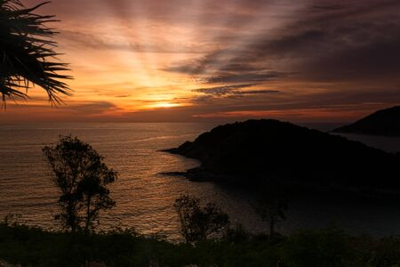 Sunset with sunbeams on the island Ko Man in Phuket; Thailand