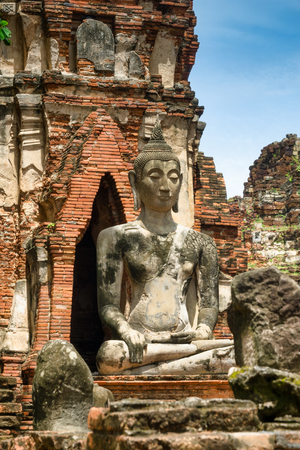 Buddha statue in the ancient historical temple complex Wat Mahathat in Ayutthaya, Thailand
