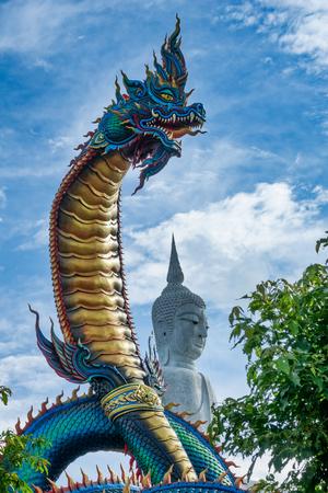 Giant Thai Naga with Buddha Statue in Phu Manorom Temple, Mukdahan, Thailand