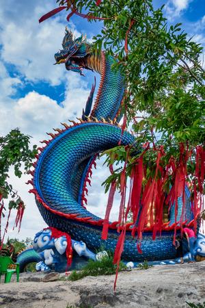 Giant Thai Naga Statue in the Phu Manorom Temple, Mukdahan, Thailand Stock Photo