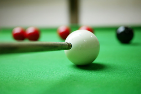 Snooker player aiming on the balck ball