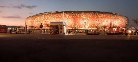 pano: Panoramic photo of the Soccer City stadium at sunset during the 2010 Fifa world cup.