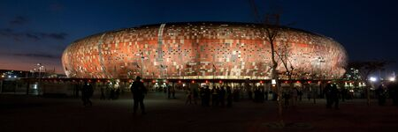 Panoramic photo of the Soccer City stadium at sunset during the 2010 Fifa world cup.