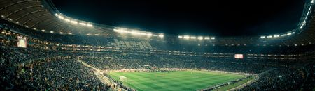 stadium: Panoramic photo inside the Soccer City stadium during the 2010 Fifa world cup., with a vintage feel. Editorial