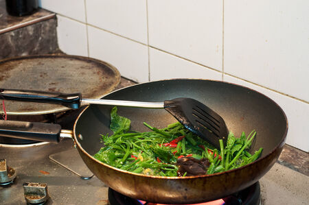 unclean: Pan is cooking on the gas stove unclean around have the scoop Stock Photo