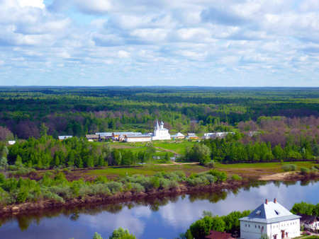 other side of: The view from the other side of the river on the female Znamensky monastery. The sun reflected in the domes. Blue sky. Gorokhovets. Russia