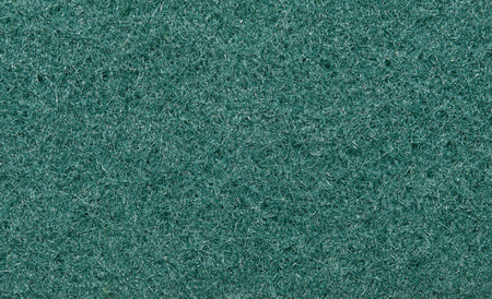 fibrous: Green, fibrous texture of the fabric. Tissue texture. Closeup