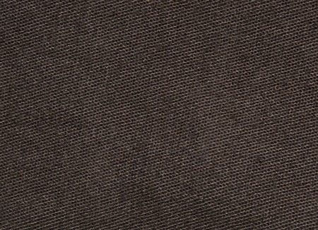 lint: Brown jeans texture with diagonal stripes, hair and lint. Closeup