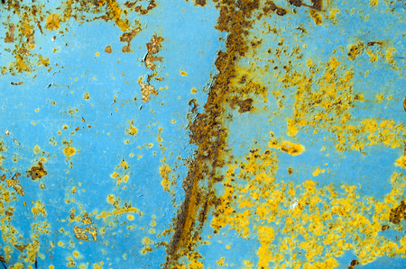 crackles: Texture of rusty metal. Yellow on blue paint