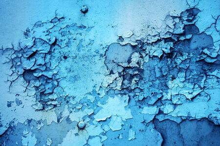 crackles: The texture of the rusting metal on blue metal Stock Photo