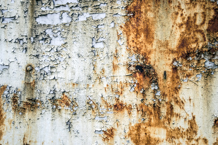 crackles: The texture of the rusting metal on a white metal Stock Photo