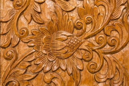 find similar images:  find similar images Pattern of flower carved on wood background