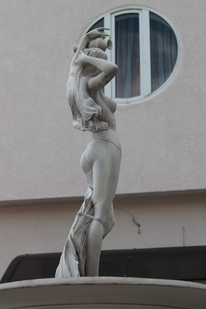 A statue of a naked girl. Sculpture