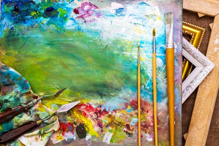 The background for the painting. Canvas Brushes palette knife. Archivio Fotografico