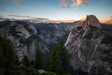 The light of the sunset over the Half Dome at the Yosemite National Park.