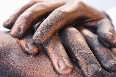 interlocked: Three bronzed hand sculptures Stock Photo