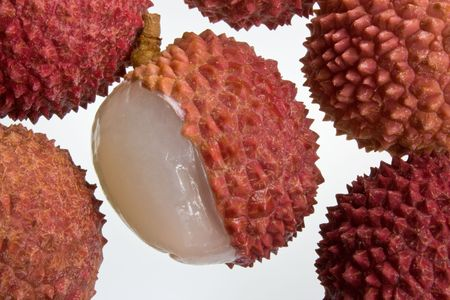 lychees: A selection of lychees against a white background
