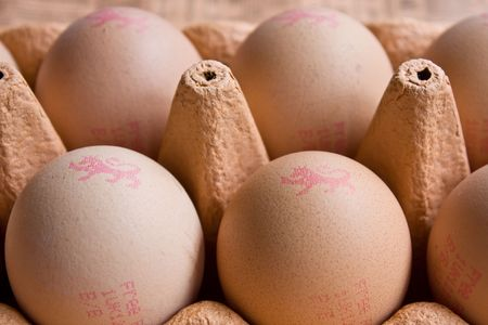 Brown Hens eggs in a cardboard container Stock Photo