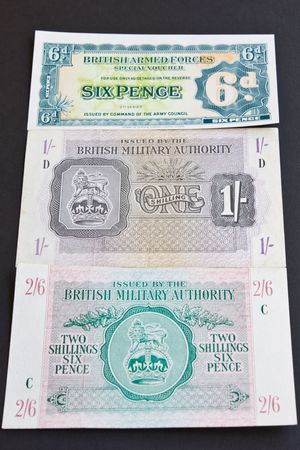 Bank notes used by the British Army overseas. Sixpence dates from 1950 and the others from the North African campaign 1943 Stock Photo - 5003134