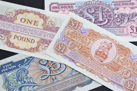 gb pound: The reverse side of bank notes used by the British Army overseas issued in 1940s and 50s