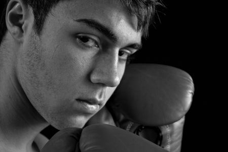 pugilist: A young boxer with his guard up