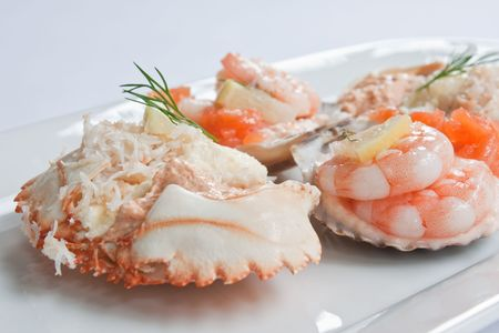 Prawns and smoked salmon in scallop shells garnished with dill and lemon Stock Photo - 5756278