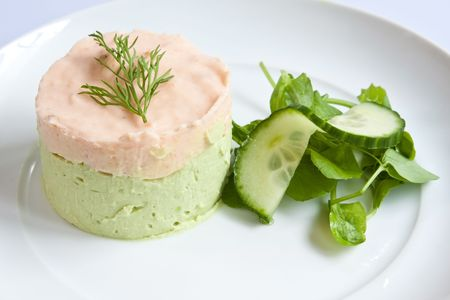 Salmon & avocado mousse garnished with dill and served with peashoots & cucumber photo