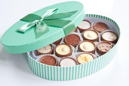 A pastel green box of handmade chocolates Stock Photo