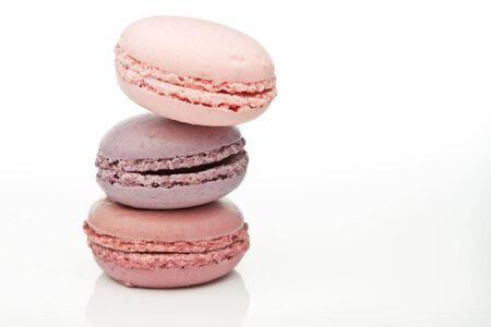 A trio of pink & violet macaroons isolated in the studio photo