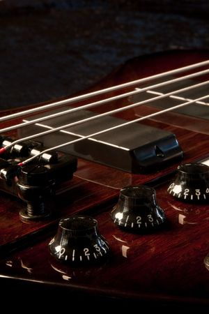 polished: A base guitar shot in the studio against a black background