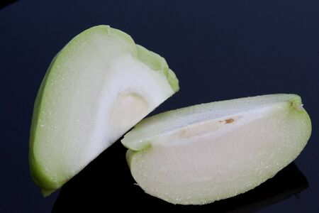 chayote: A sliced chayote, also known as chow chow & christophene Stock Photo
