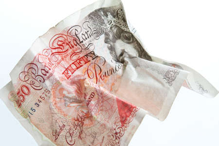 50: A crumpled British fifty pound note against a white background Stock Photo
