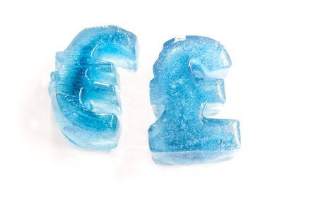 meltdown: Frozen pound& euro currency symbols depicting economic meltdown, frozen assets Stock Photo