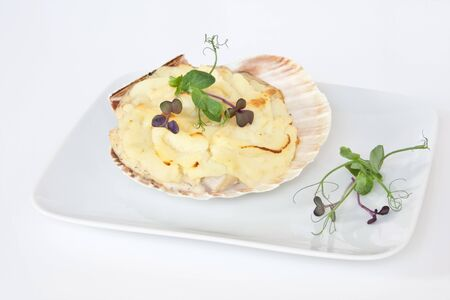 jacques: Coquilles Saint Jacques, a typical French dish consiting of scallops, prawns & fish in a creamy sauce topped with mashed potato ans garnished with pea shoots & radish cress