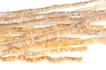 crackling: Fingers of pork crackling against a white background
