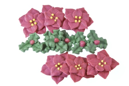 sugarcraft: Edible sugarcraft Christmas cake decorations consisting of pointsettia flowers & holly leaves