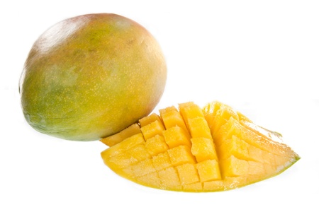 cubed: Mangoes with one slice cubed, isolated against a white background