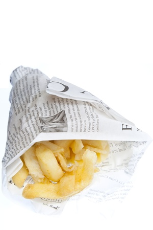 traditionally: A portion of chips traditionally wrapped in newspaper & set against a white background Stock Photo